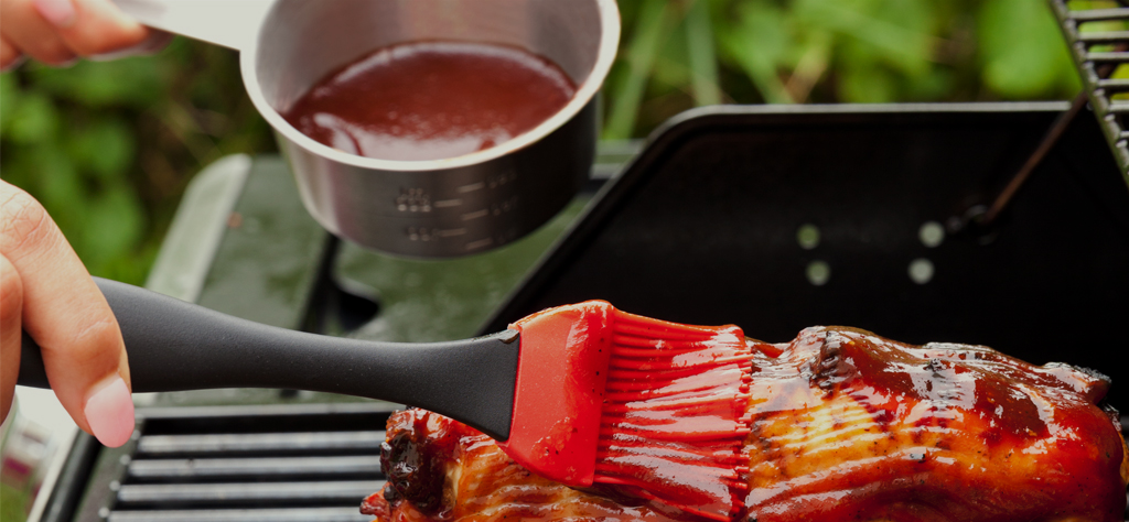 basting meat on grill