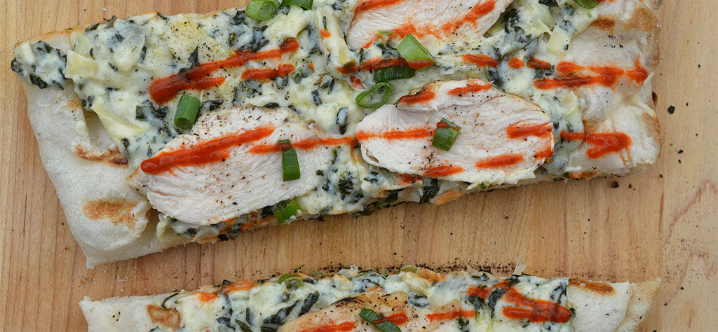 Grilled spinach and artichoke flatbread with chicken and sriracha