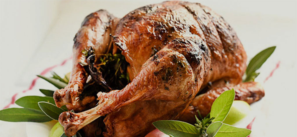 Herb Butter Rotisserie Turkey off the grill