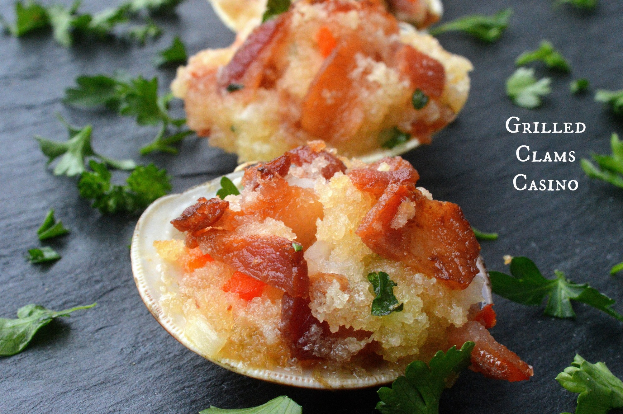 Grilled Clams Casino Loaded with Bacon and full of flavor these are always the star of the party!