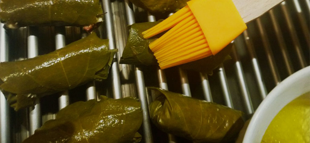 basting grilled grape leaves